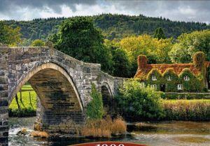 Puzzle Castorland  1000 dílků - Vesnický domek s mostem ve Walesu  104673